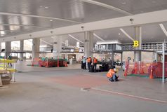 Worker installing floor in the construction of an airport. royalty free stock photos