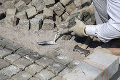 Worker installing granite cubes 3 Royalty Free Stock Photography