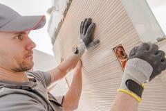 Worker Installing Large Tile stock image