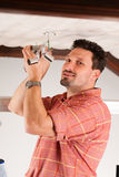 Worker is installing a luster Royalty Free Stock Photo