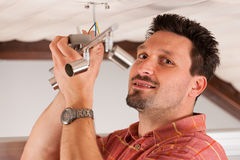 Worker is installing a luster Royalty Free Stock Photos
