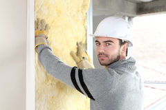 Worker installing new insulation Stock Photos