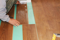 Worker installing new laminate flooring Stock Photography