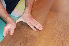 Worker installing new laminate flooring Royalty Free Stock Images