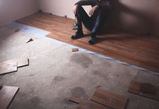 Worker installing new laminate wooden floor stock image