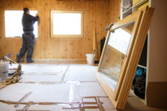 Worker installing new wooden windows Royalty Free Stock Photo
