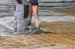 Worker installing reinforcement mesh Royalty Free Stock Photo