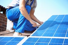Worker installing solar panels. Outdoors Royalty Free Stock Photos