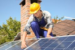Worker installing solar panels. Outdoors Royalty Free Stock Image