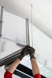 Worker Installing an Vent Duct Royalty Free Stock Images