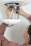 Worker installing a water heater Stock Images