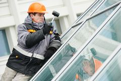 Worker installing window Stock Images