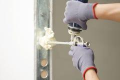 The worker installs the door stock images