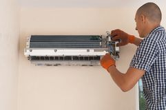 Installation of air conditioner royalty free stock image