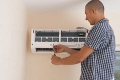 Installation and repair of air conditioner royalty free stock photos