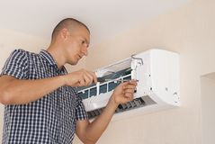 Installation and repair of air conditioner stock image