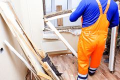The worker installs plastic windows and doors. The worker tools installs plastic windows and doors stock photos