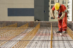 Worker Installs Rebar - Horizontal Stock Photo