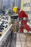 Worker Installs Rebar - Vertical royalty free stock photos