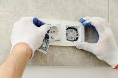 Worker installs ventilation grille. Stock Photos