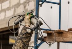 Worker insulates the walls of the house with plastic panels stock photo