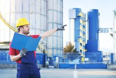 Worker isolated on industrial factory background Royalty Free Stock Photography