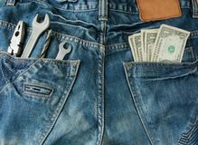 Worker jeans with money and tools Royalty Free Stock Image