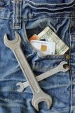 Worker Jeans With Money And Tools Stock Photos