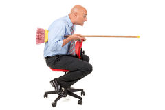 Worker jousting. Worker in a chair jousting with a broom Royalty Free Stock Images