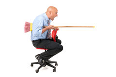 Worker jousting. Worker in a chair jousting with a broom Royalty Free Stock Photos