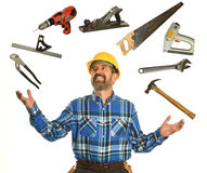 Worker Juggling Tools. Confident worker juggling tools isolated over white background royalty free stock photos