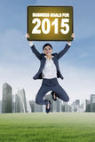 Worker jumps with business goals for 2015 Royalty Free Stock Photos