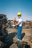 Worker in a junkyard Royalty Free Stock Photography