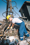 Worker in a junkyard Royalty Free Stock Images