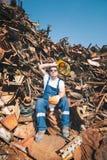 Worker in a junkyard Stock Image
