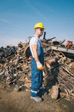 Worker in a junkyard Stock Images