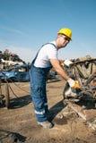 Worker in a junkyard Royalty Free Stock Photo