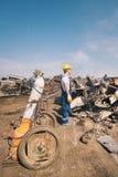 Worker in a junkyard Stock Photos