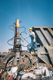 Worker in a junkyard Stock Photography