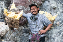 Worker at Kawah Ijen posing for a picture Stock Image