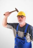 Worker knocks on his helmet Stock Photography