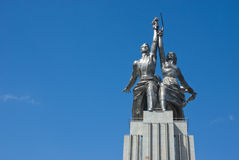 Worker and Kolkhoz Woman Royalty Free Stock Photography