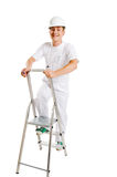 Worker on a ladder Stock Photo