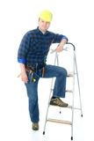 Worker and ladder. Worker (handyman) standing near his ladder Stock Image