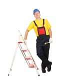 Worker on ladder with brush. Royalty Free Stock Image