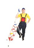 Worker on ladder with buckets. Stock Photos