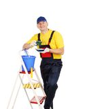 Worker on ladder with cup of tea Royalty Free Stock Images