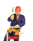 Worker on ladder with hammer Royalty Free Stock Photography