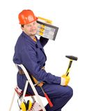 Worker on ladder with hammer and toolbox Royalty Free Stock Photo