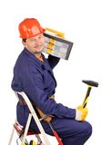Worker on ladder with hammer and toolbox. Stock Photos